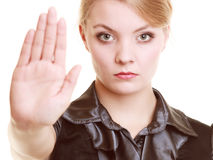 Businesswoman showing stop hand sign gesture Stock Photos
