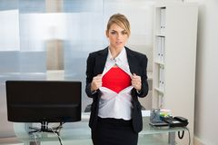 Businesswoman showing superhero costume Stock Image