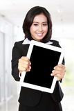 Businesswoman showing tablet Royalty Free Stock Images