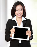 Businesswoman showing tablet Stock Image