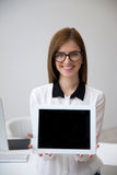 Businesswoman showing tablet computer screen Stock Photography