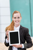Businesswoman Showing Tablet PC Stock Image