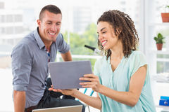 Businesswoman showing tablet to her colleague Royalty Free Stock Image