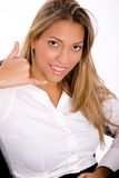 Businesswoman showing telephonic gesture Royalty Free Stock Photos