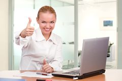 Businesswoman showing thumb up Stock Images