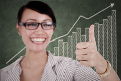 Businesswoman showing thumb up Royalty Free Stock Images