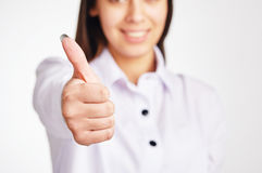 Businesswoman Showing Thumb up. Business woman shows thumb up Stock Photography
