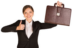 Businesswoman showing thumb up and holding Stock Image