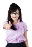 Businesswoman showing thumb up isolated Stock Images