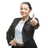 Businesswoman showing thumb up Stock Photo