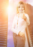 Businesswoman showing thumbs up Royalty Free Stock Image