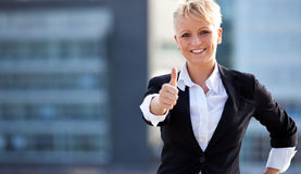 Businesswoman showing thumbs up Stock Images
