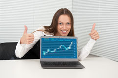 Businesswoman showing thumbs up Stock Photos