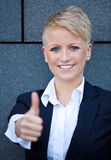 Businesswoman showing thumbs up Royalty Free Stock Images