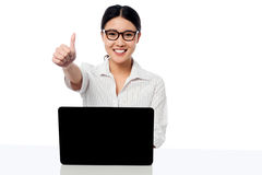 Businesswoman showing thumbs up gesture Royalty Free Stock Photos