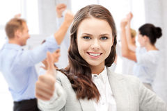 Businesswoman showing thumbs up in office Royalty Free Stock Image