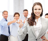 Businesswoman showing thumbs up in office Royalty Free Stock Photo