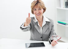 Businesswoman showing thumbs up sign Royalty Free Stock Image