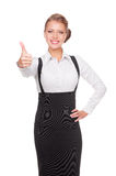 Businesswoman showing thumbs up and smiling Stock Photos