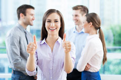 Businesswoman showing thumbs up Stock Photo