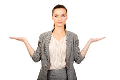 Businesswoman showing two empty hands. Stock Images