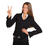 Businesswoman showing victory sign Stock Images