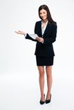 Businesswoman showing welcome gesture Stock Images