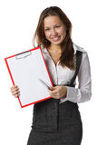 Businesswoman shows blank clipboard Royalty Free Stock Photography