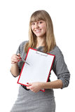 Businesswoman shows blank clipboard Stock Photo