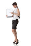 Businesswoman shows blank clipboard Royalty Free Stock Image
