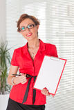 Businesswoman shows blank clipboard. Royalty Free Stock Photos