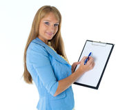 Businesswoman shows blank clipboard. Royalty Free Stock Image