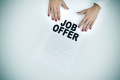 Businesswoman shows a document with the text job offer Stock Images