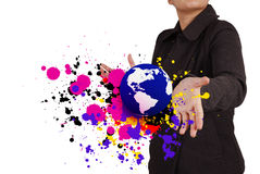 Businesswoman shows the earth and splash colors Stock Photo