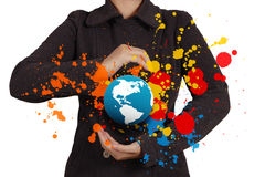 Businesswoman shows the earth and splash colors Stock Images
