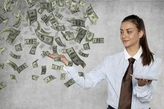 Businesswoman shows how easy it is to get rich online Stock Photo