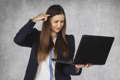 Businesswoman shows the information on the internet are stupid. Business woman shows the information on the internet are stupid royalty free stock photo