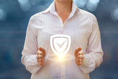 A businesswoman shows installed protection . Stock Photography