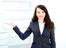 Businesswoman shows in the office. stock images