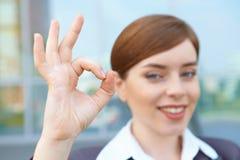 Businesswoman shows ok sing. Royalty Free Stock Photo