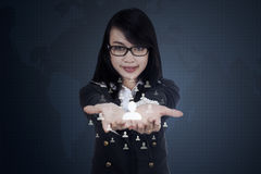 Businesswoman shows social network icon Stock Photos
