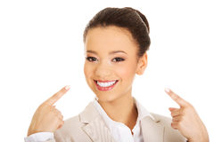 Businesswoman shows us her smile. Stock Image