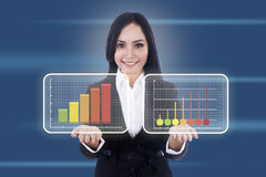 Businesswoman shows virtual diagrams Stock Image