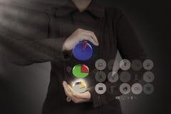 Businesswoman  shows virtual pie chart Royalty Free Stock Photo