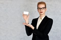 Businesswoman shows white card Stock Images
