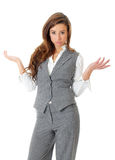 Businesswoman shrugging, isolated on white Stock Image