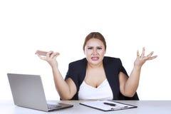 Businesswoman shrugs her shoulder Stock Image
