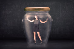 Businesswoman shut inside a glass jar concept Royalty Free Stock Photography