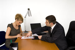 Businesswoman signing the contract. Businesswoman and businessman in office Stock Images