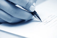 Businesswoman signing contract Stock Photos